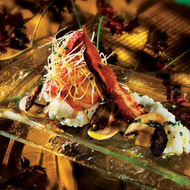 Lobster tail dish with bacon and vegetables