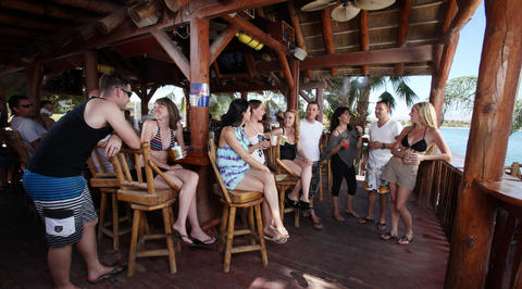 Group of people relaxing at outdoor ocean bar