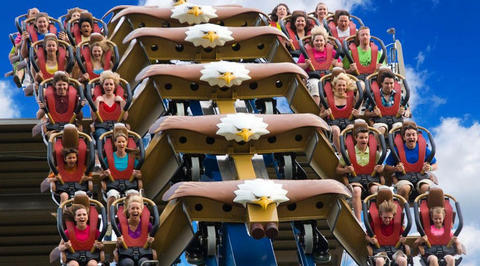 Large group of people riding rollercoaster