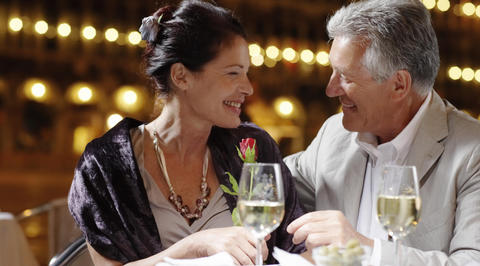 Man and woman drinking white wine together