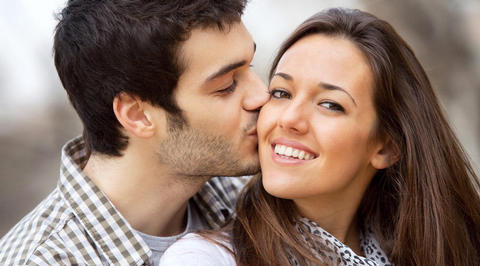 Man kissing woman on the cheek